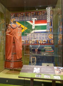 Display case containing a Xhosa woman's outfit and South African beadwork
