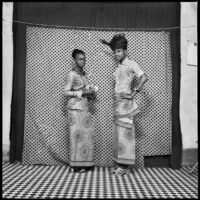 Studio portrait of two young women wearing wax print wrappers
