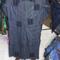 a long cotton shirt dress made of indigo adire and aso-oke fabric