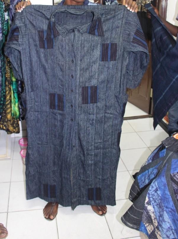 a long cotton shirt dress made of indigo adire and aso-oke fabric