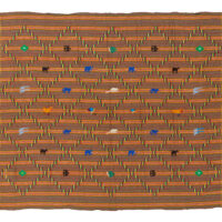 Brown and orange kente cloth with colourful animal motifs