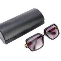 square black rimmed sunglasses next to a black case